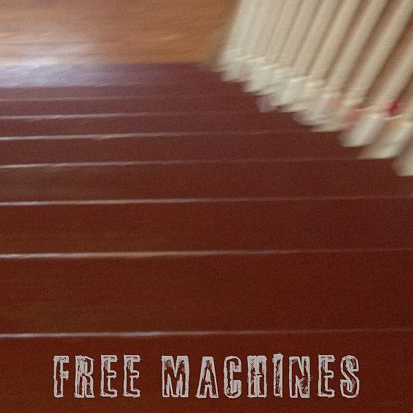 Cover FREE MACHINES, cursive moon