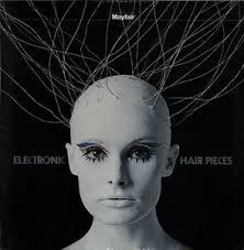 Cover MORT GARSON, electronic hair pieces