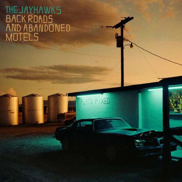 Cover JAYHAWKS, black roads and abandoned motels