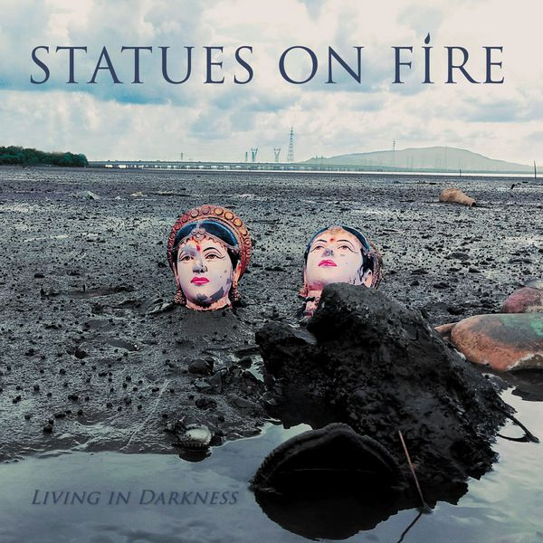 Cover STATUES ON FIRE, living in darkness