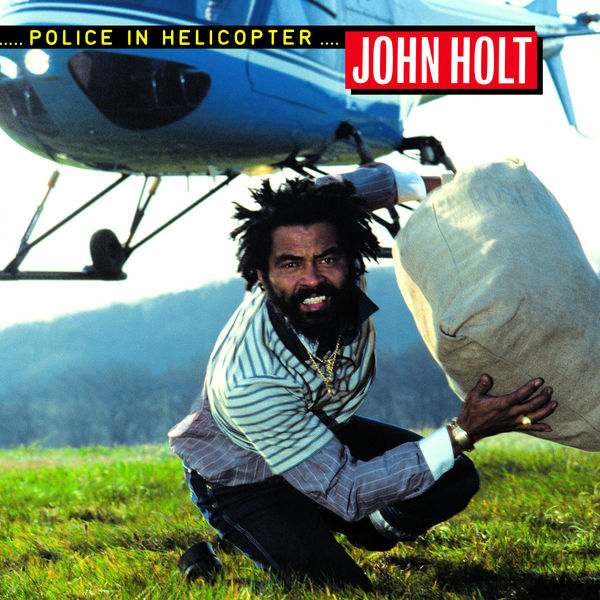 Cover JOHN HOLT, police in helicopter