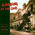 THE EX & TOM CORA, scrabbling at the lock cover